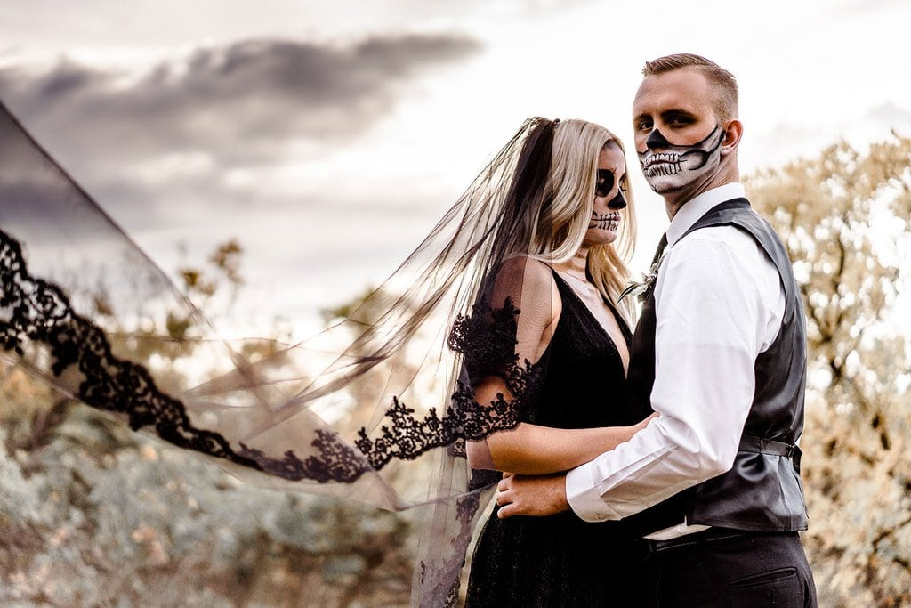 Bride and groom portrait with black cathedral veil.