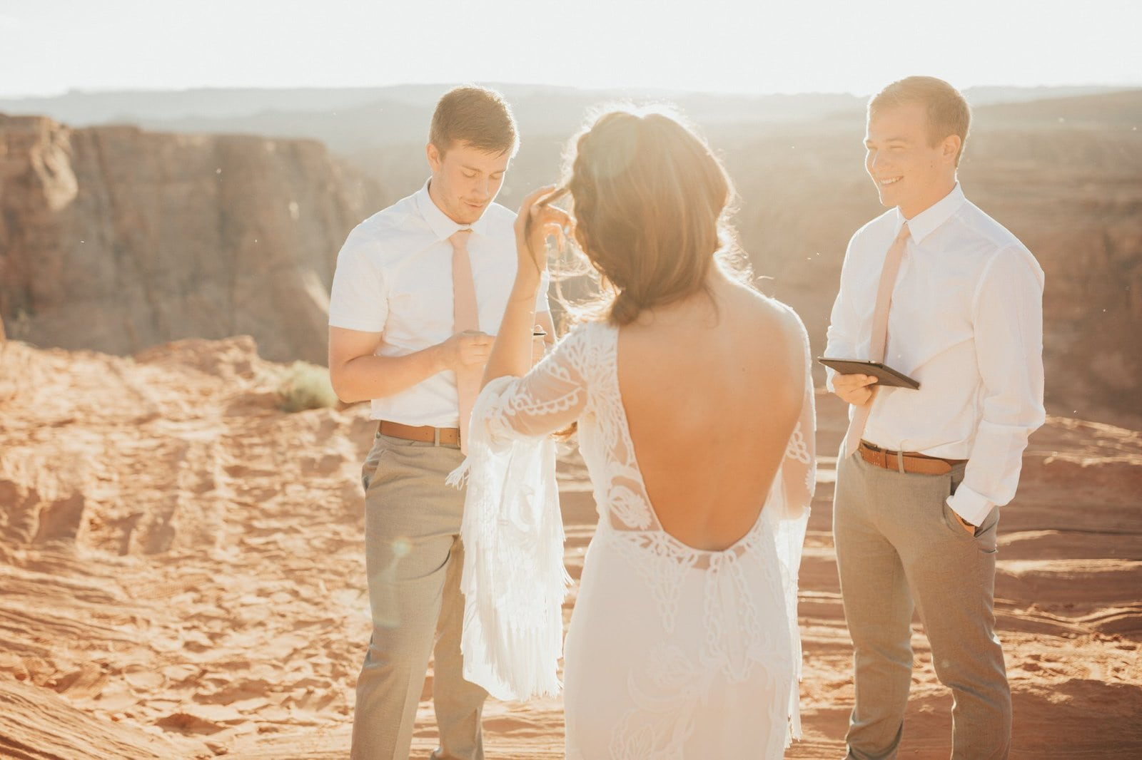Groom exchanging vows for intimate elopement.