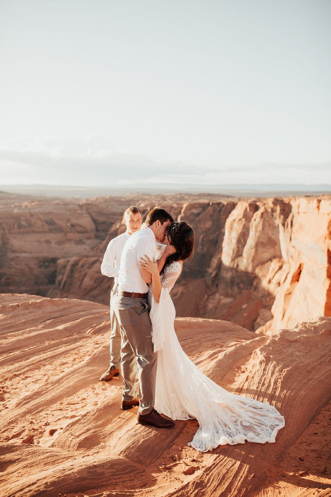 bride and groom share their first kiss at Horseshoe Bend.