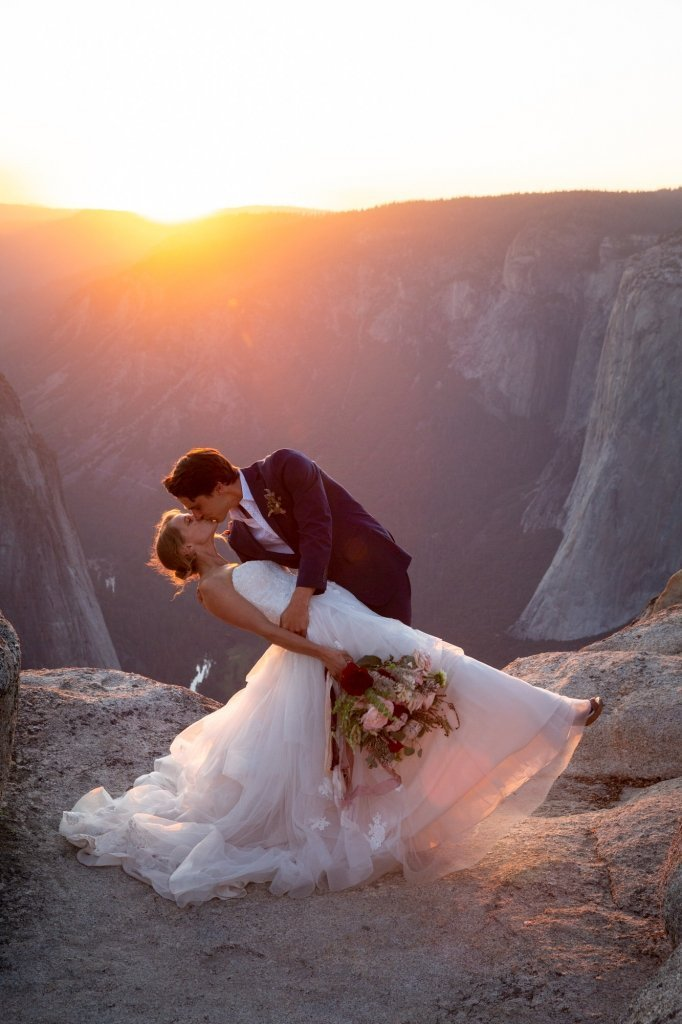 sunset elopement as grooom dips bride