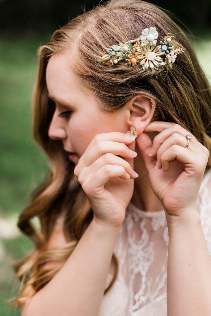 bride adjusting her earrings.