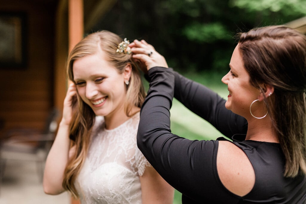 bride's mom adjusting hair piece.