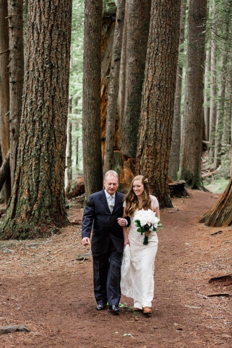 bride and father walking down the aisle at Mount. Rainier.