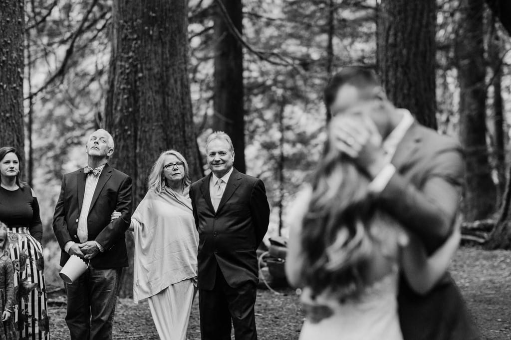 Bridal party looking at couple dancing at Mount Rainier.