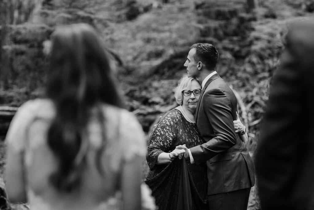 groom and mom dance in the woods of Mount Rainier.