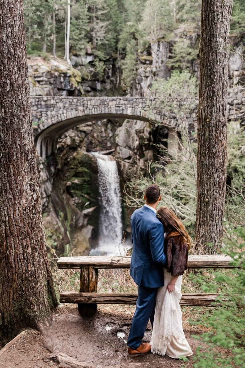 bride and groom portrait by waterfall.
