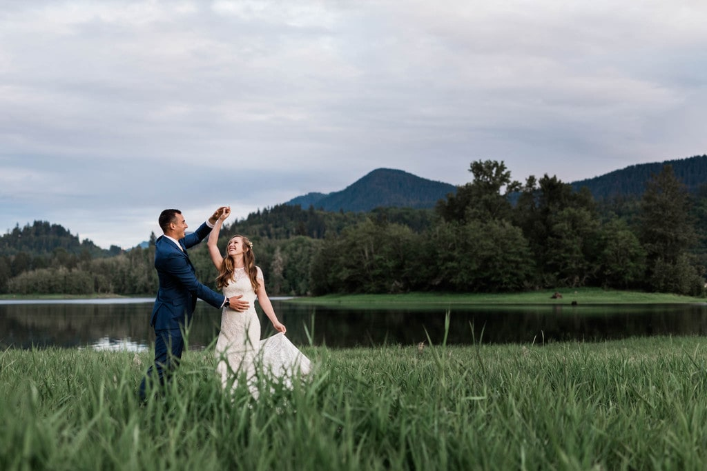 Bride and groom dancing at Mount Rainier national park.