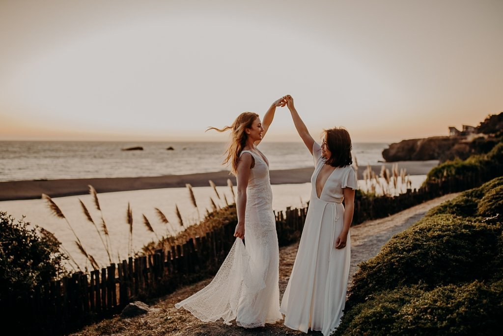brides dancing as they celebrate their elopement.