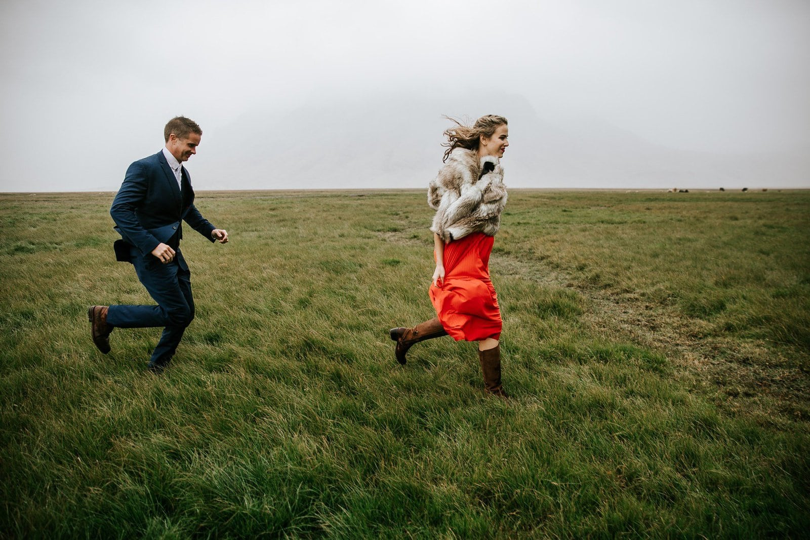 Fun shot of bride and groom running.
