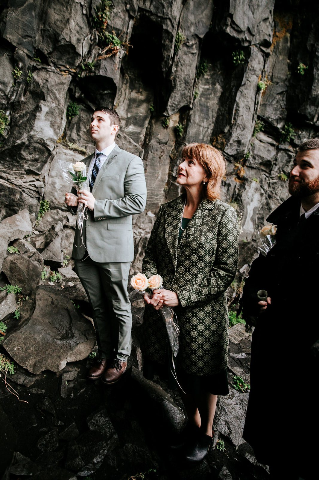 Intimate family at rainy Iceland ceremony.