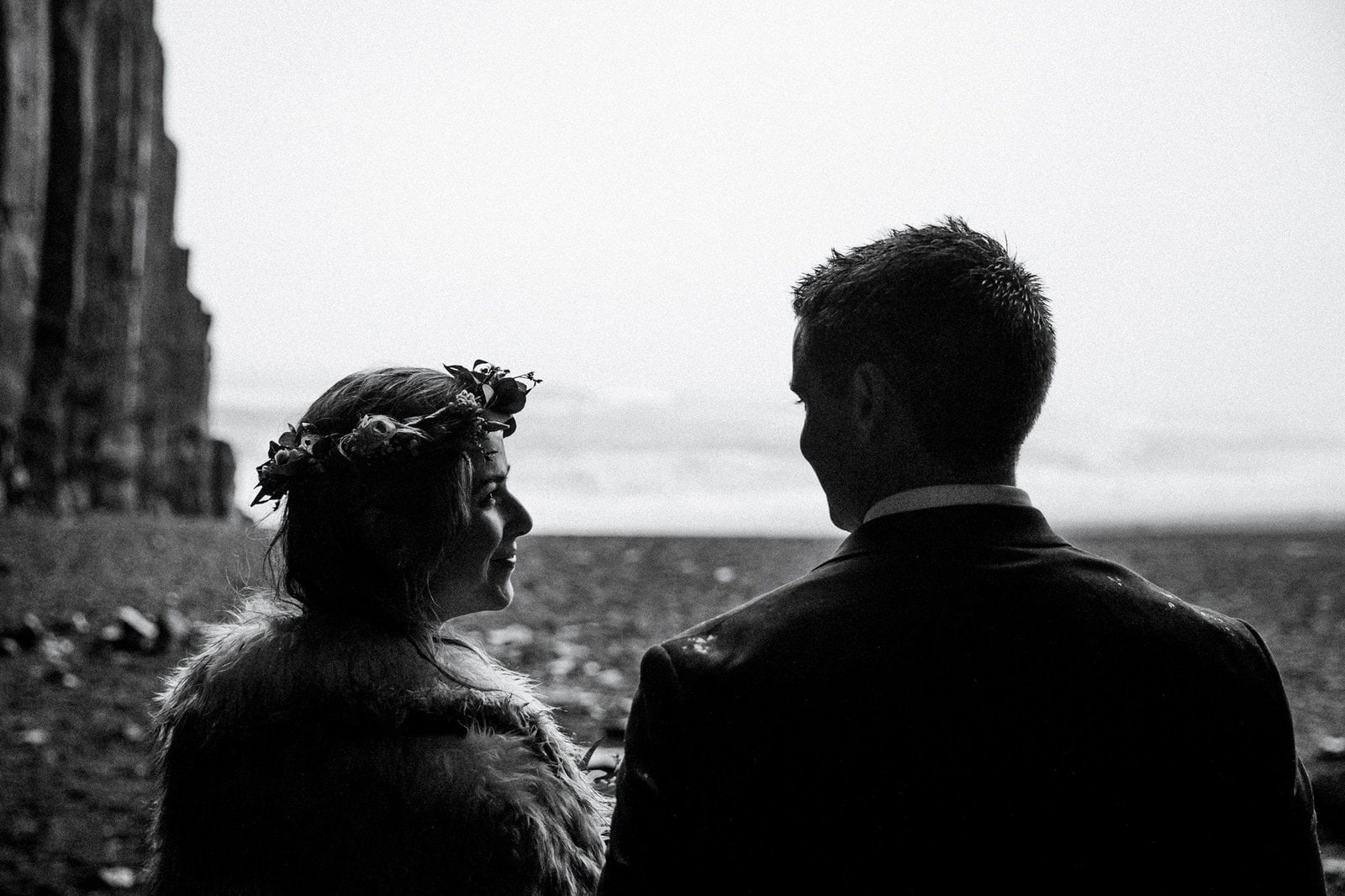 Bride and groom during rainy Iceland elopement.