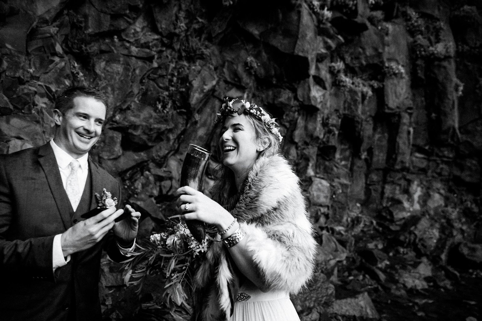 Bride and groom toasting during Iceland ceremony.