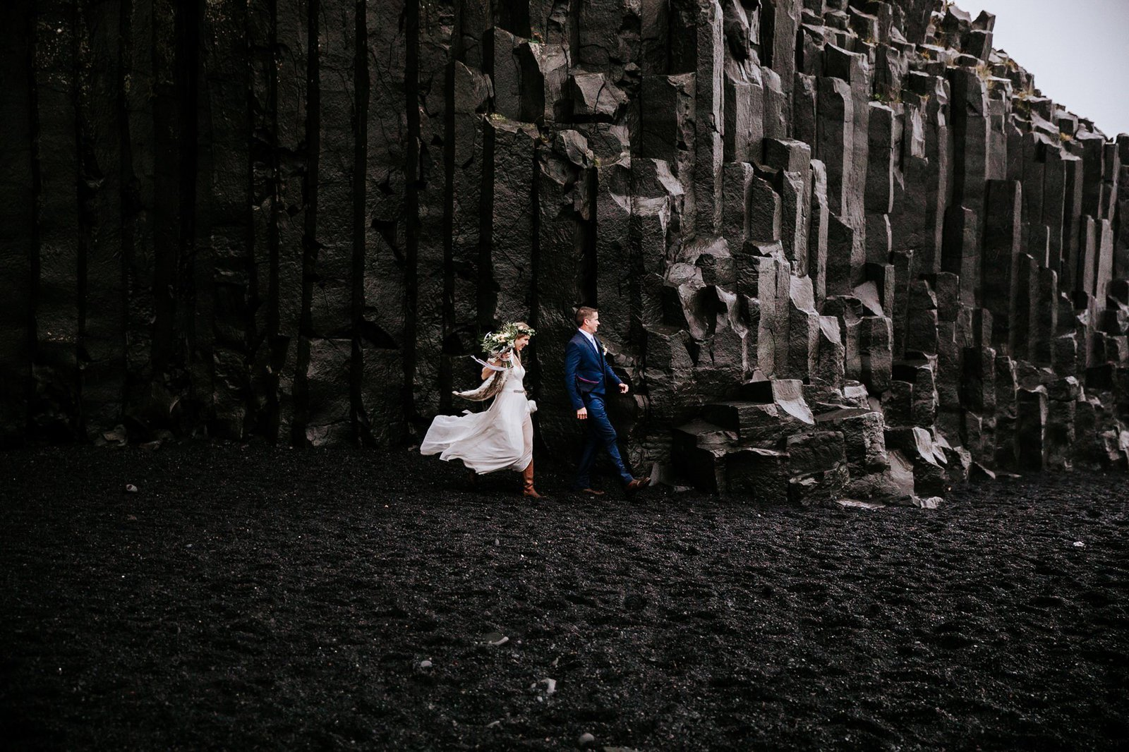 Bride and groom at Reynisfjara beach.