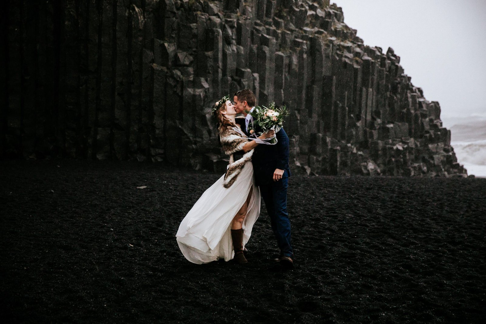 Bride and groom kiss in Iceland.