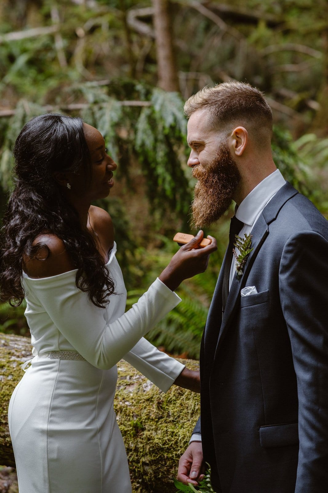 Bride combing her groom's beard.