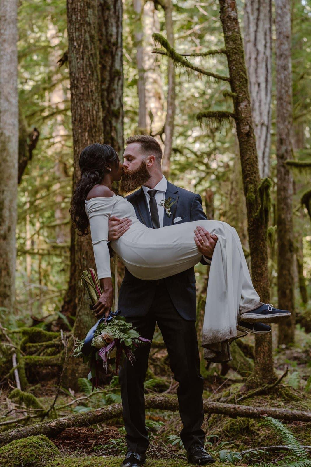 Groom picks up bride in Olympic National Park.