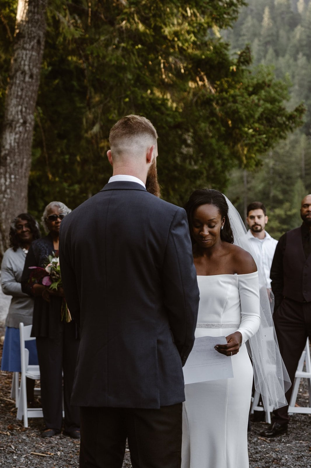 Exchanging vows with the groom.