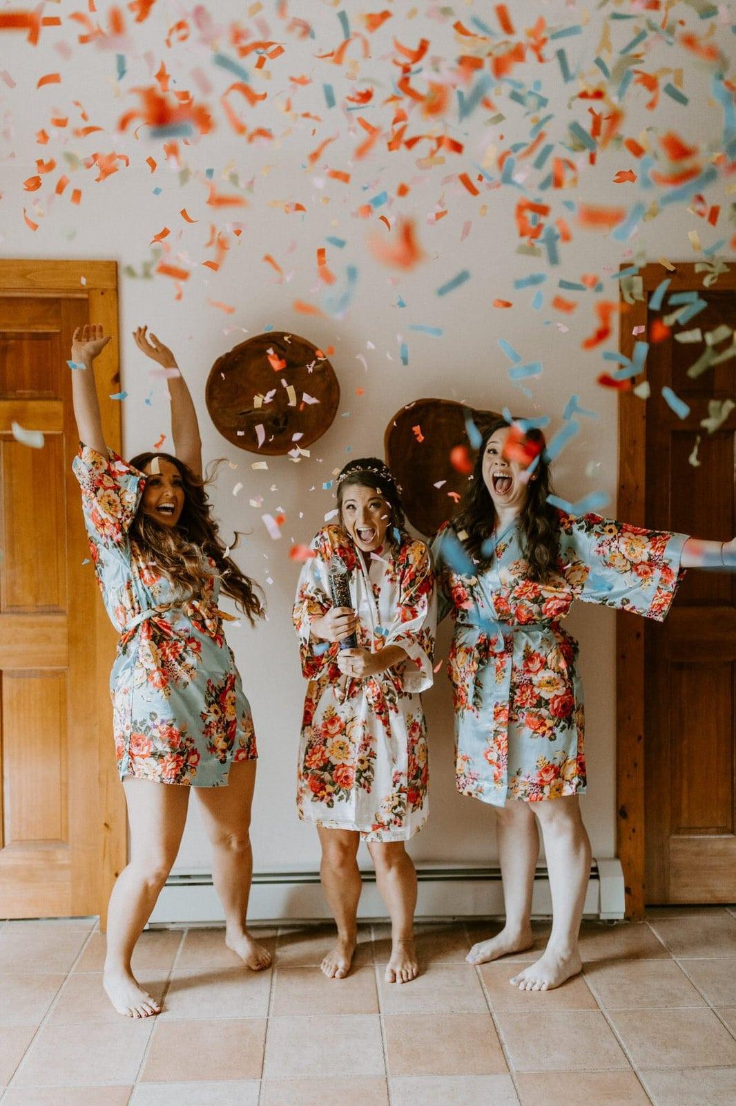 bride and her bridesmaids celebrating wedding.