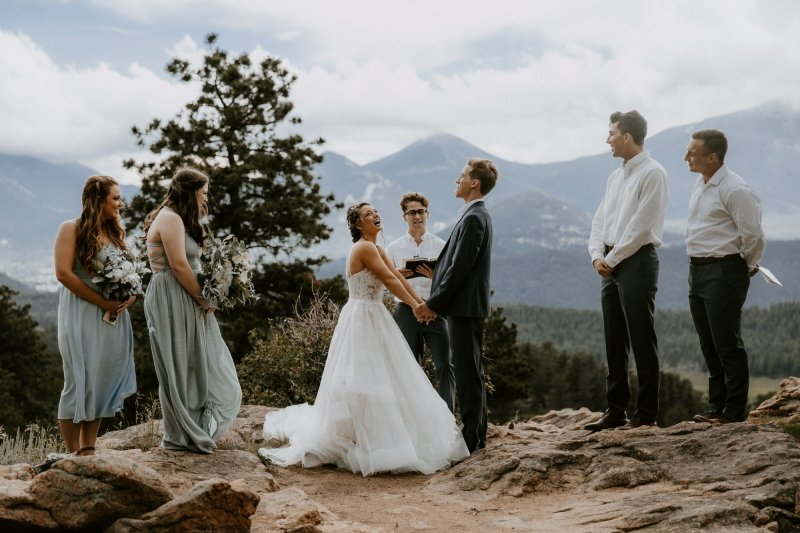 bride and groom laughing during ceremony at Rocky Mountain.
