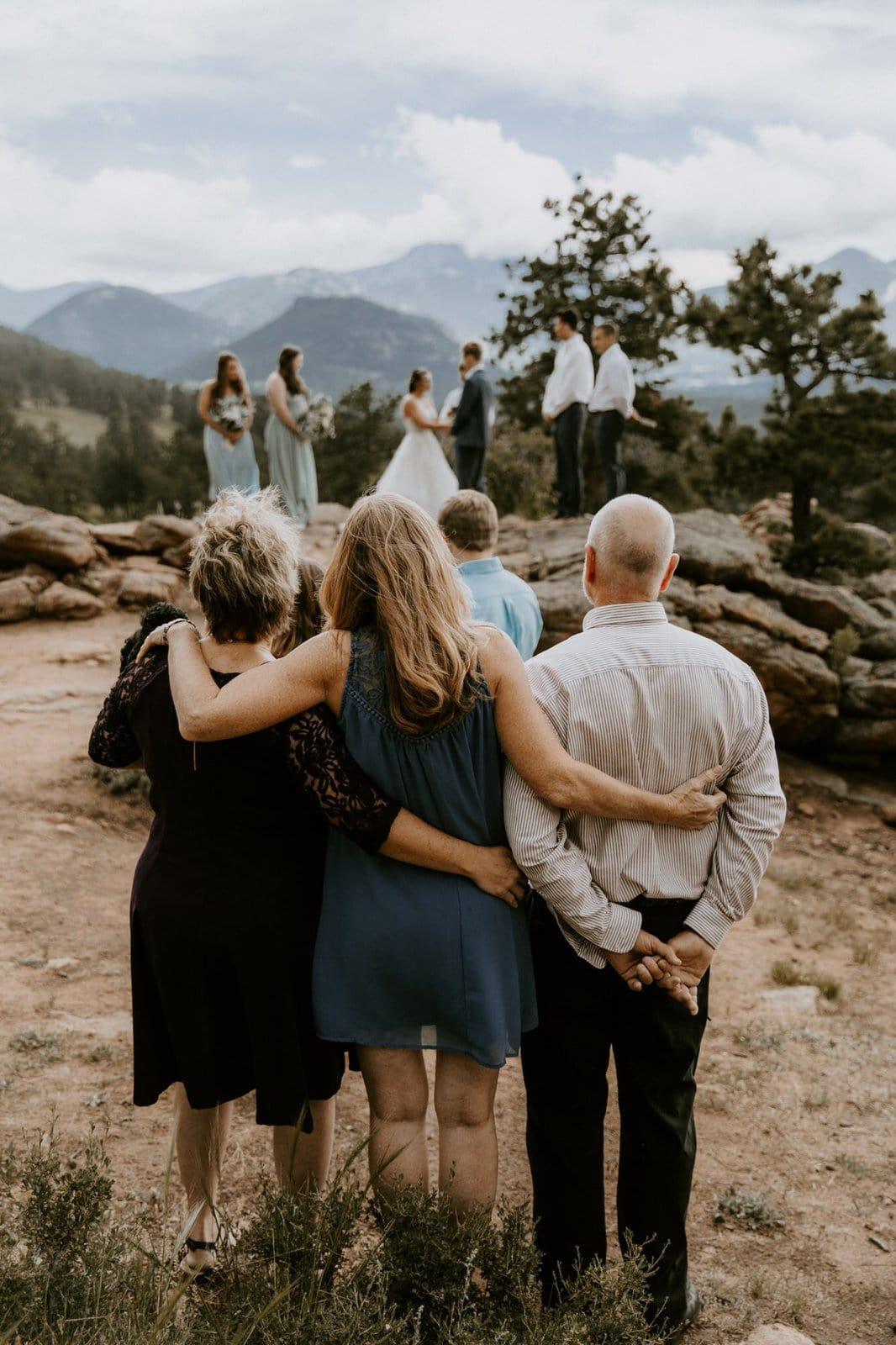 parents overlooking wedding ceremony.