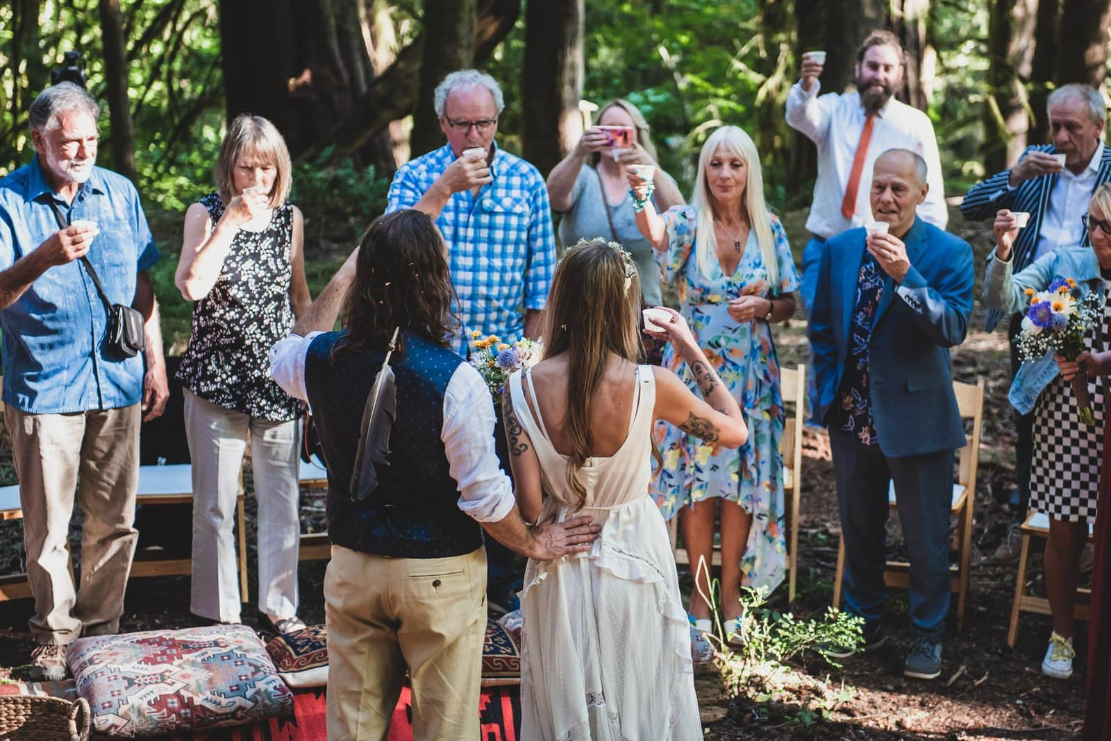 Bride and groom toasts with intimate family.