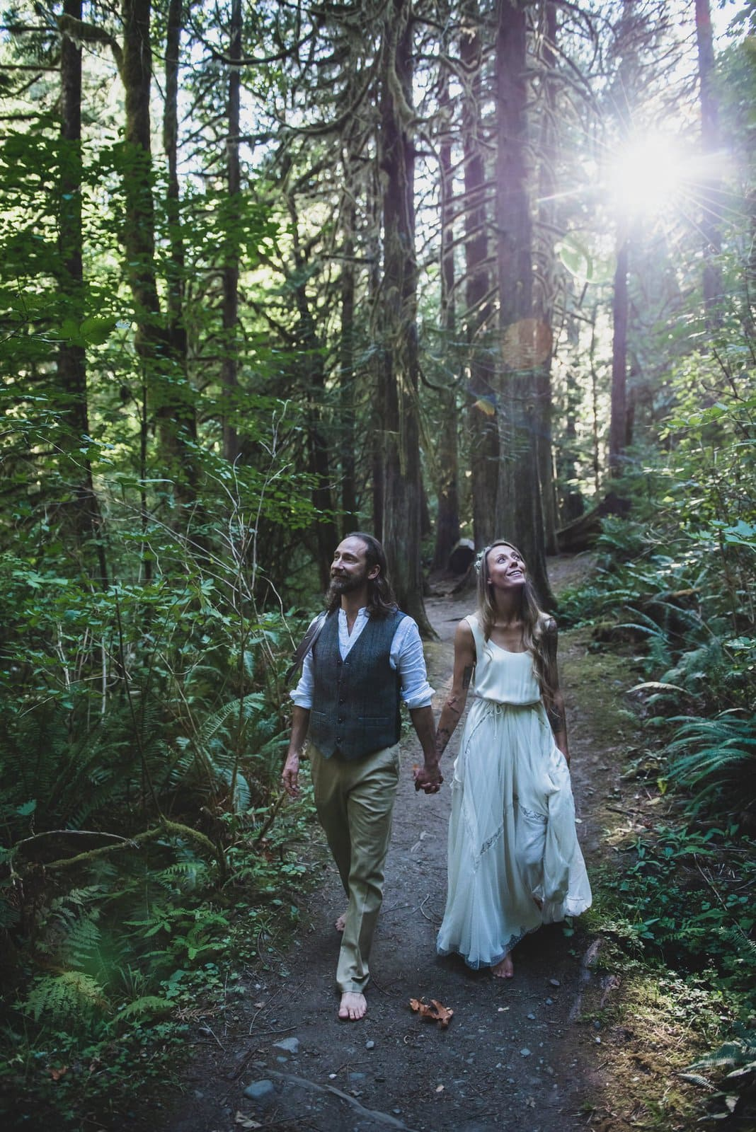 Bride and groom portraits in intimate forest wedding.