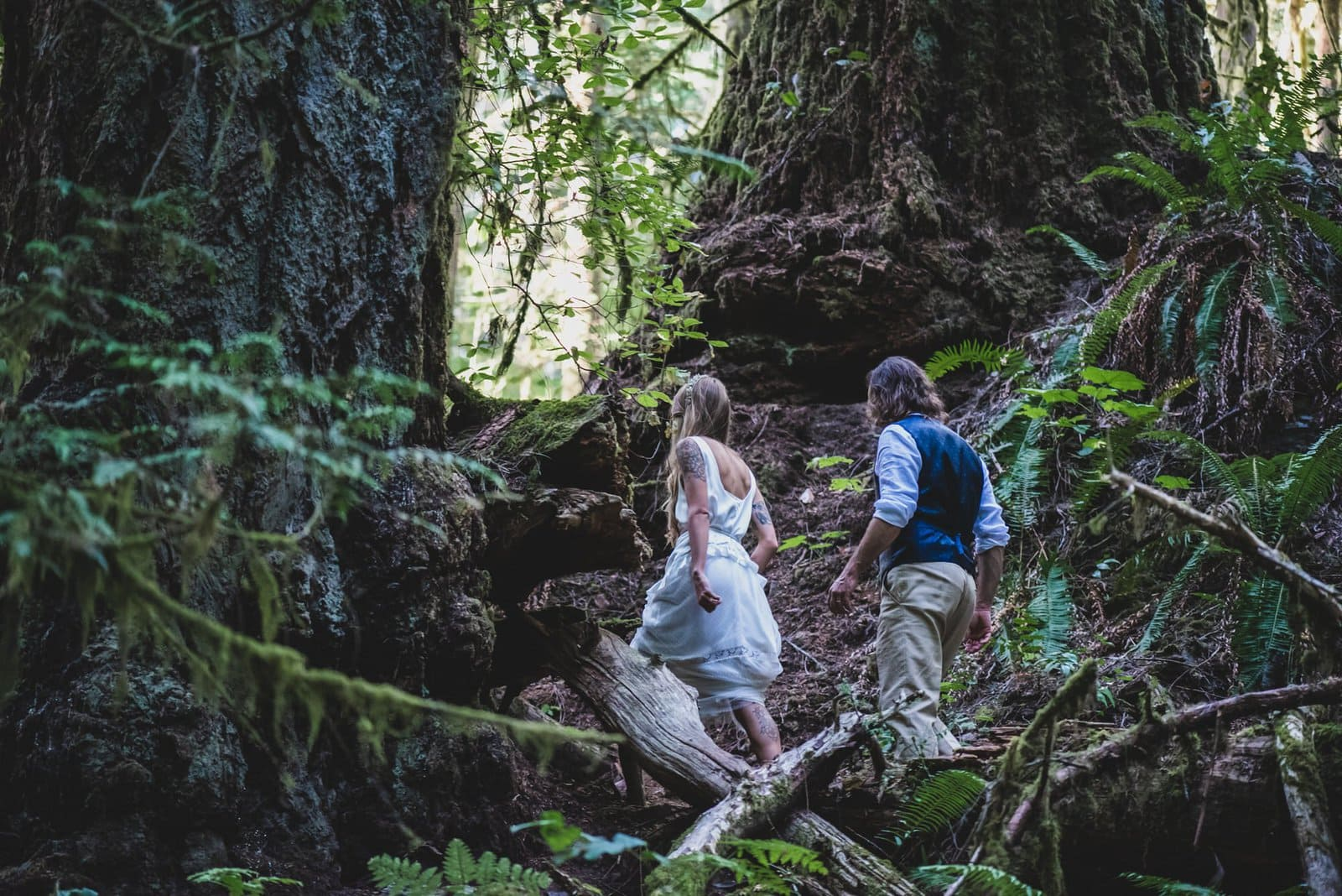 Bride and groom hike in Vancouver Island.