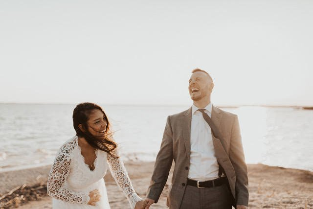 Couple laughing during elopement.