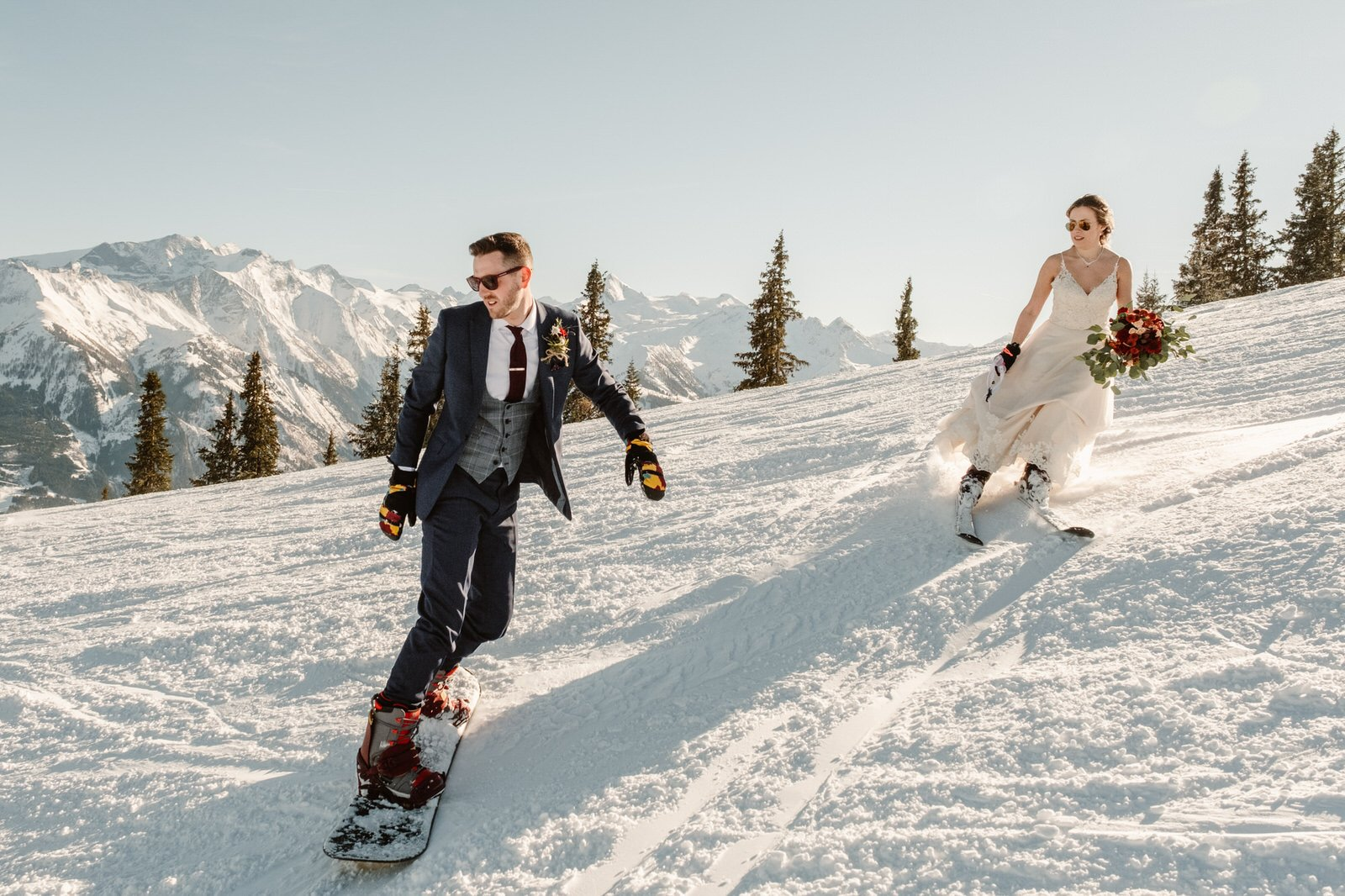 winter wedding photo ideas with couple skiing.