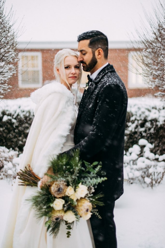 Bride and groom during winter wedding in the holidays.