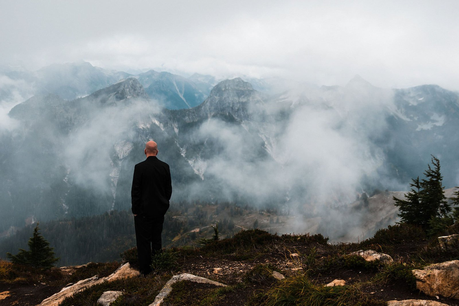groom awaiting his bride on a mountain.