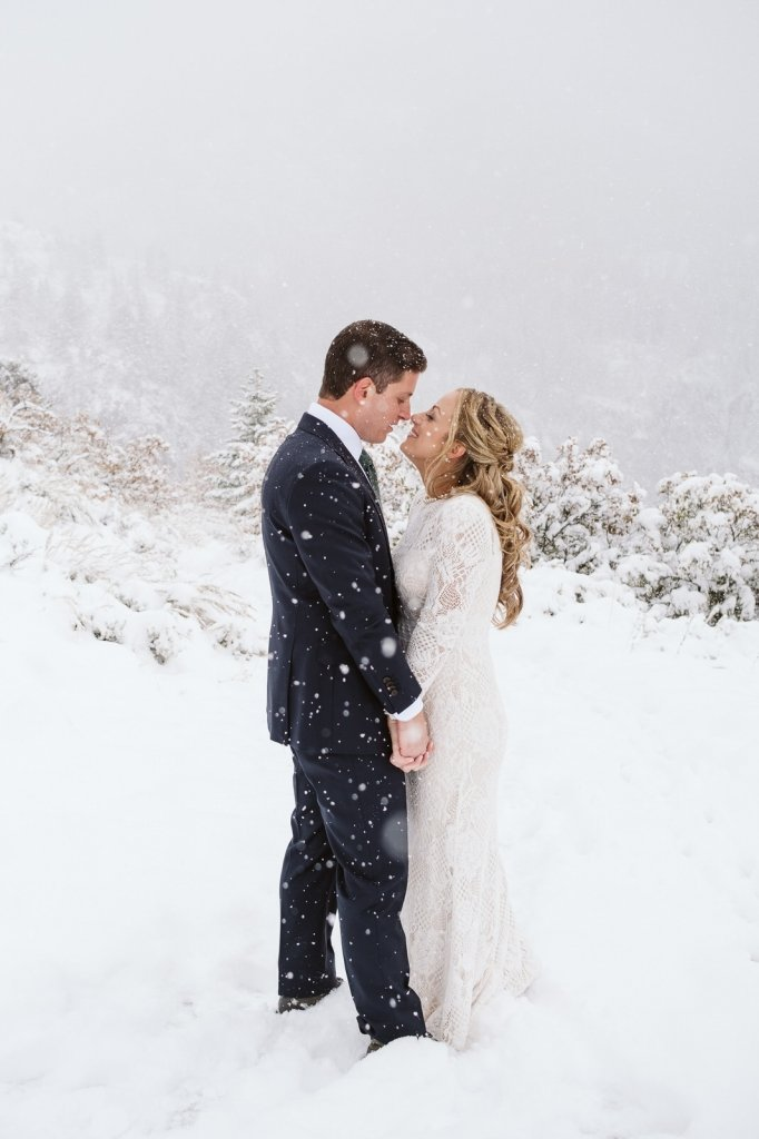 winter snowfall during bride and groom portraits.