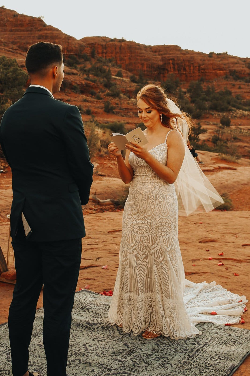 wife reads her vows during elopement ceremony