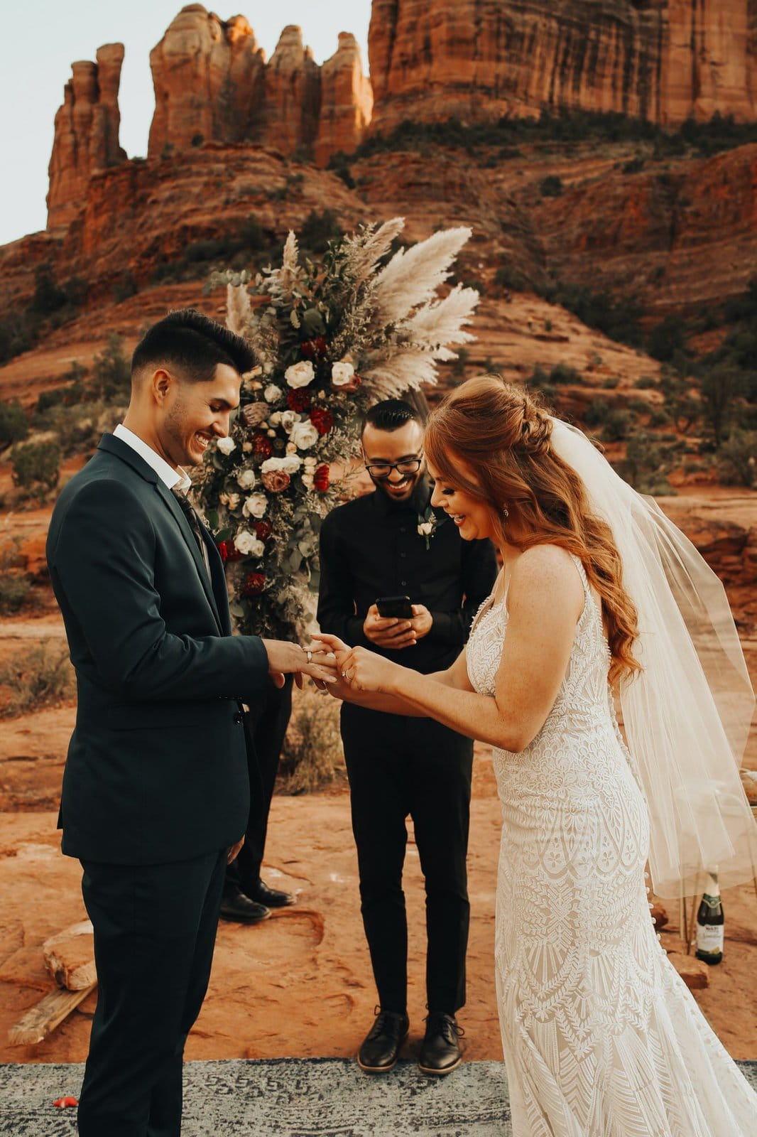 groom places rings on wife's finger