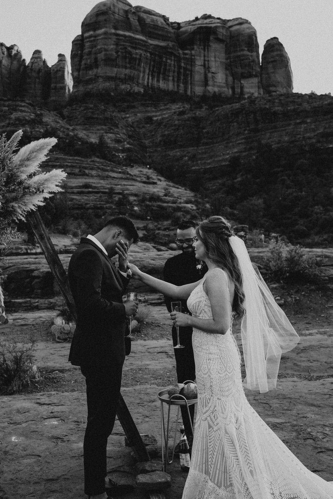 groom gets sentimental during sedona elopement.