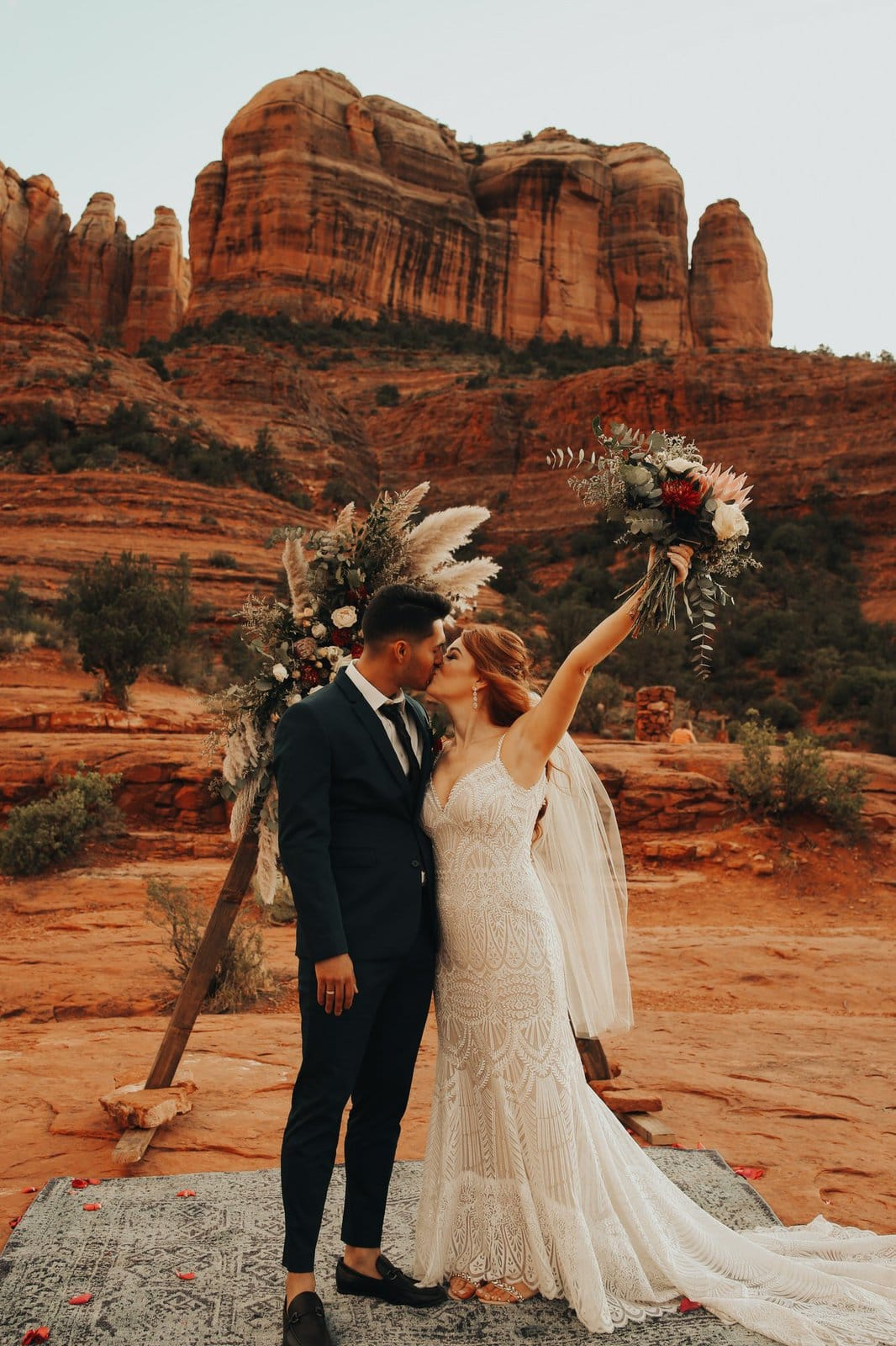 Bride and groom celebrate marriage at Red rock in Sedona.