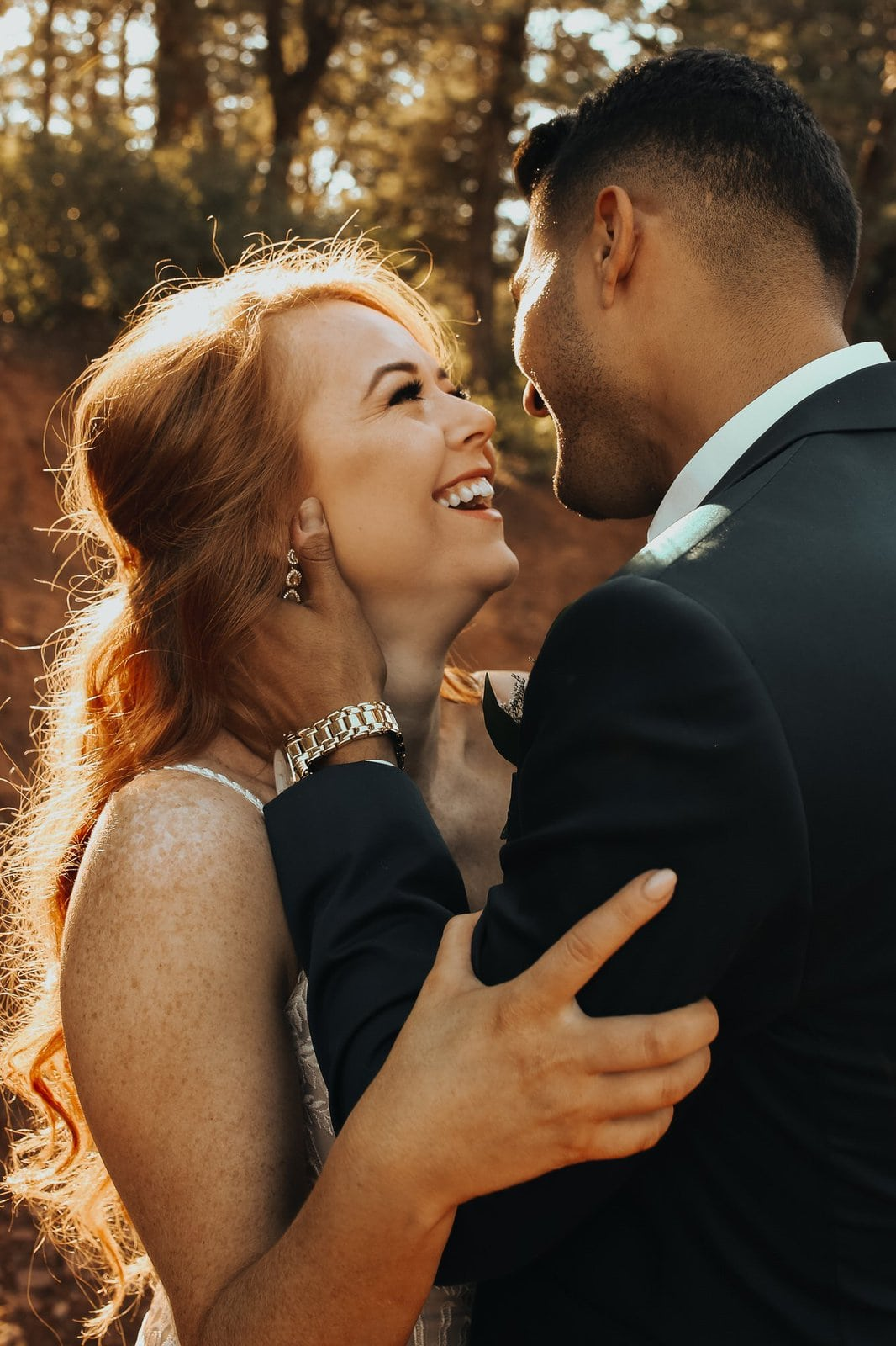 Bride laughs with her husband.
