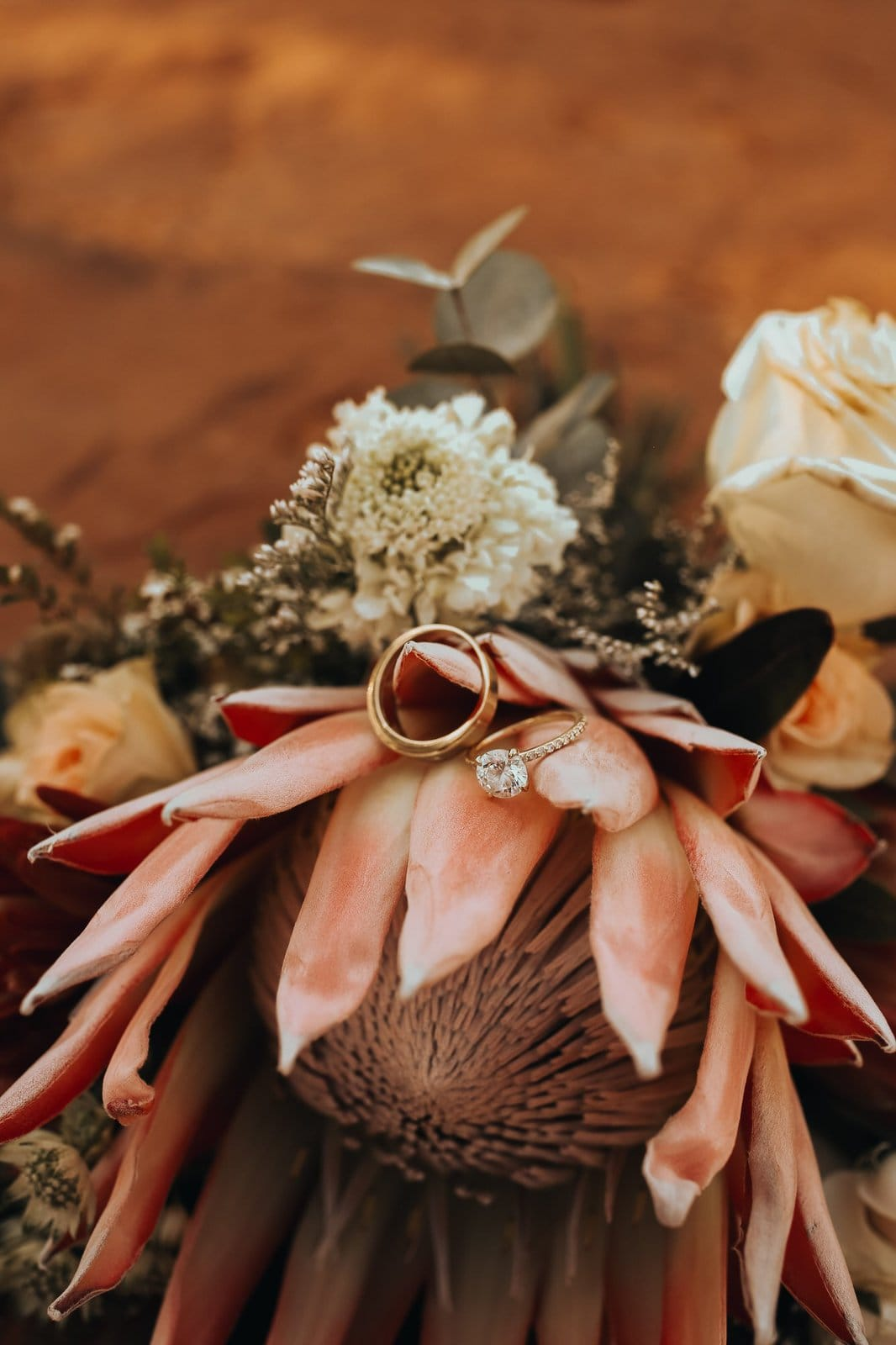 Bouquet detail shot with wedding bands.