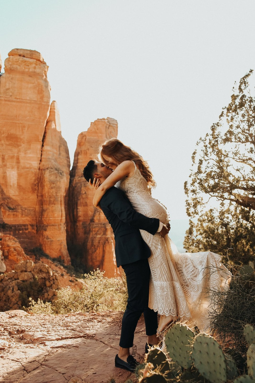 Couple kissing at Cathedral rock.