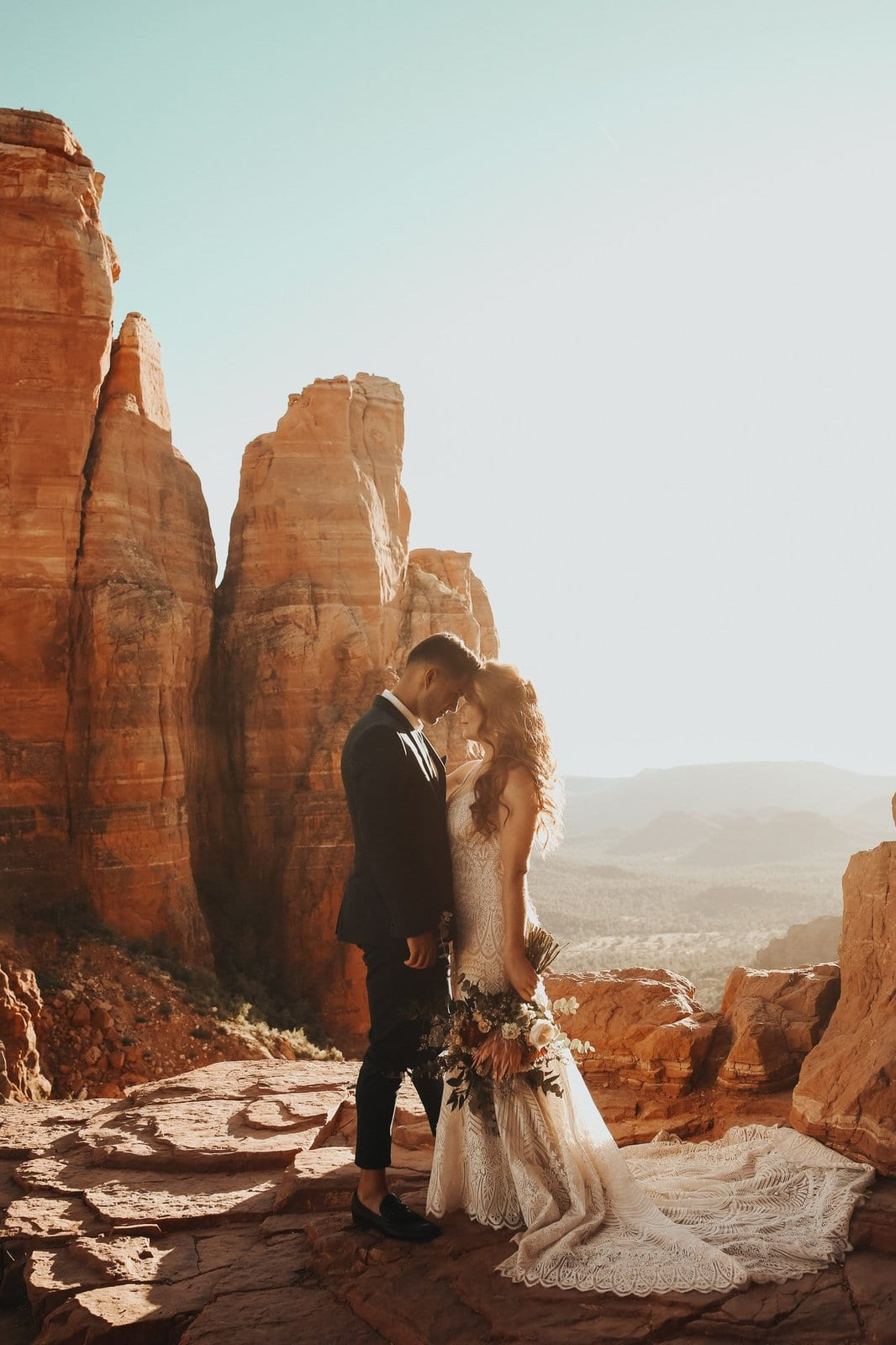 Couple kiss during sunset elopement at Cathedral rock.