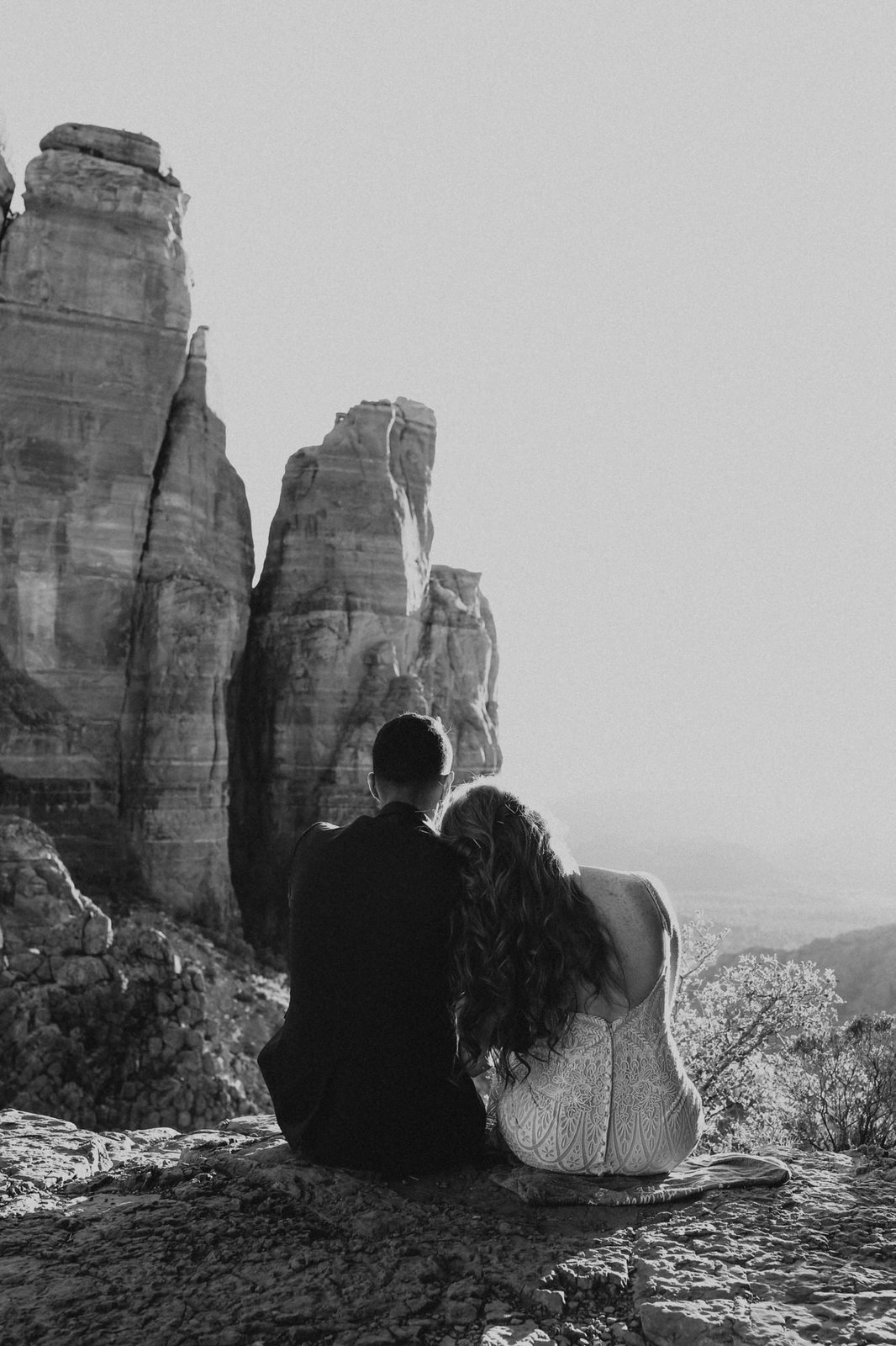 detail shot of couple admiring cathedral rock.