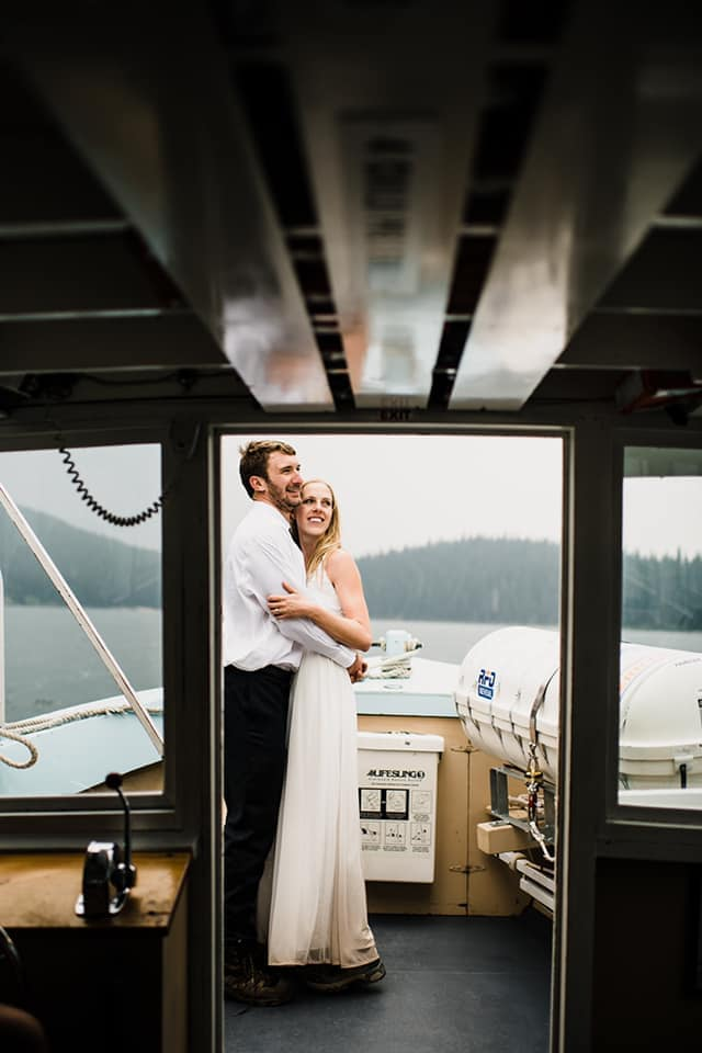 Bride and groom dancing on a boat.