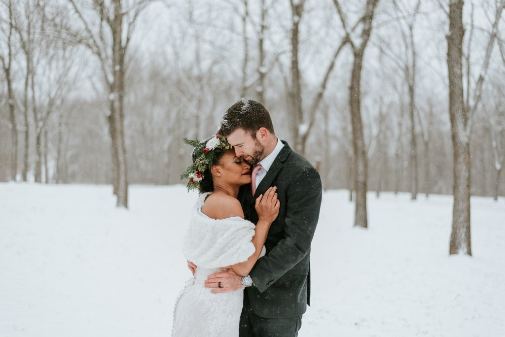 winter elopement couple snuggle.