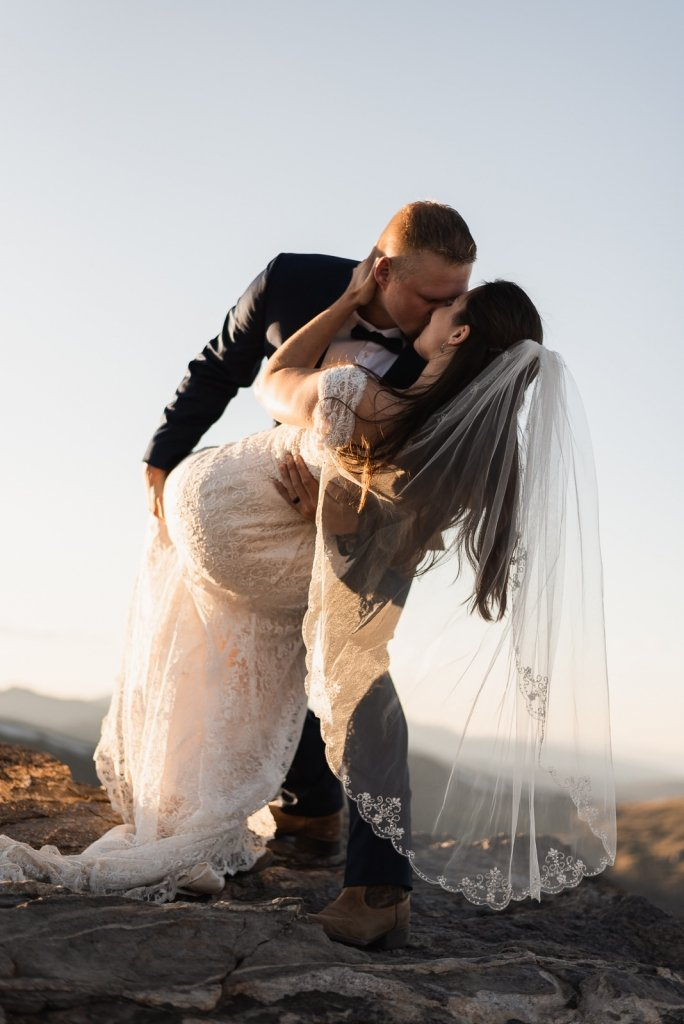 Groom dips his bride during first dance.