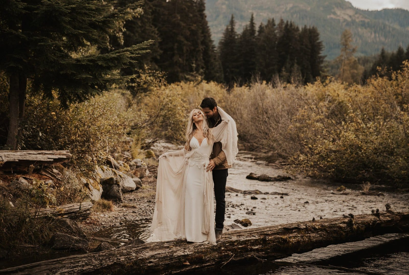 bride and groom by pond.