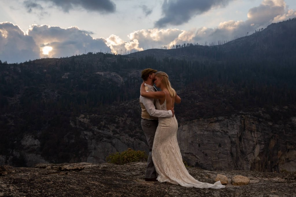 Bride and groom dancing on the mountain.