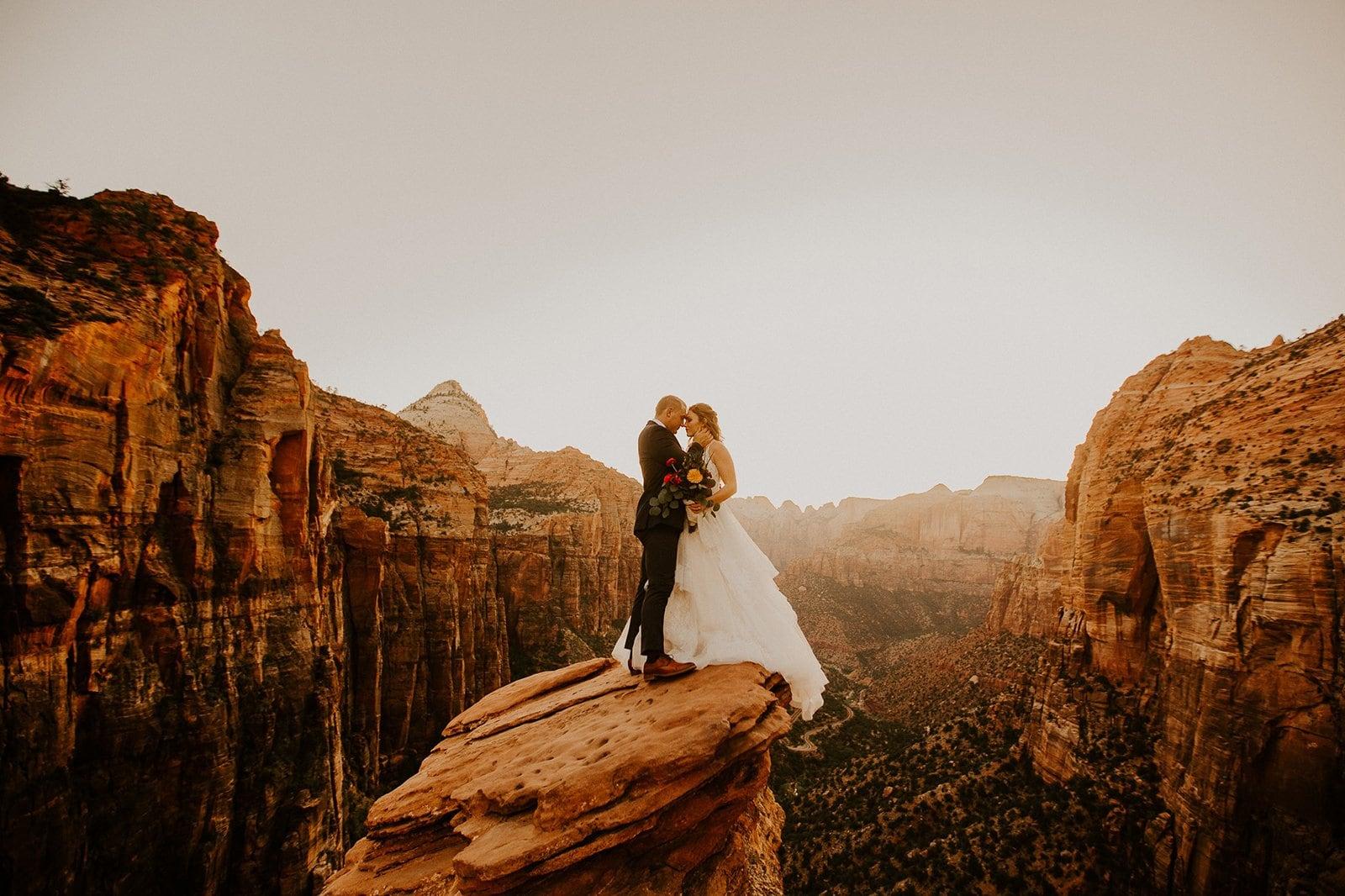 zion national park elopement photos on a rock