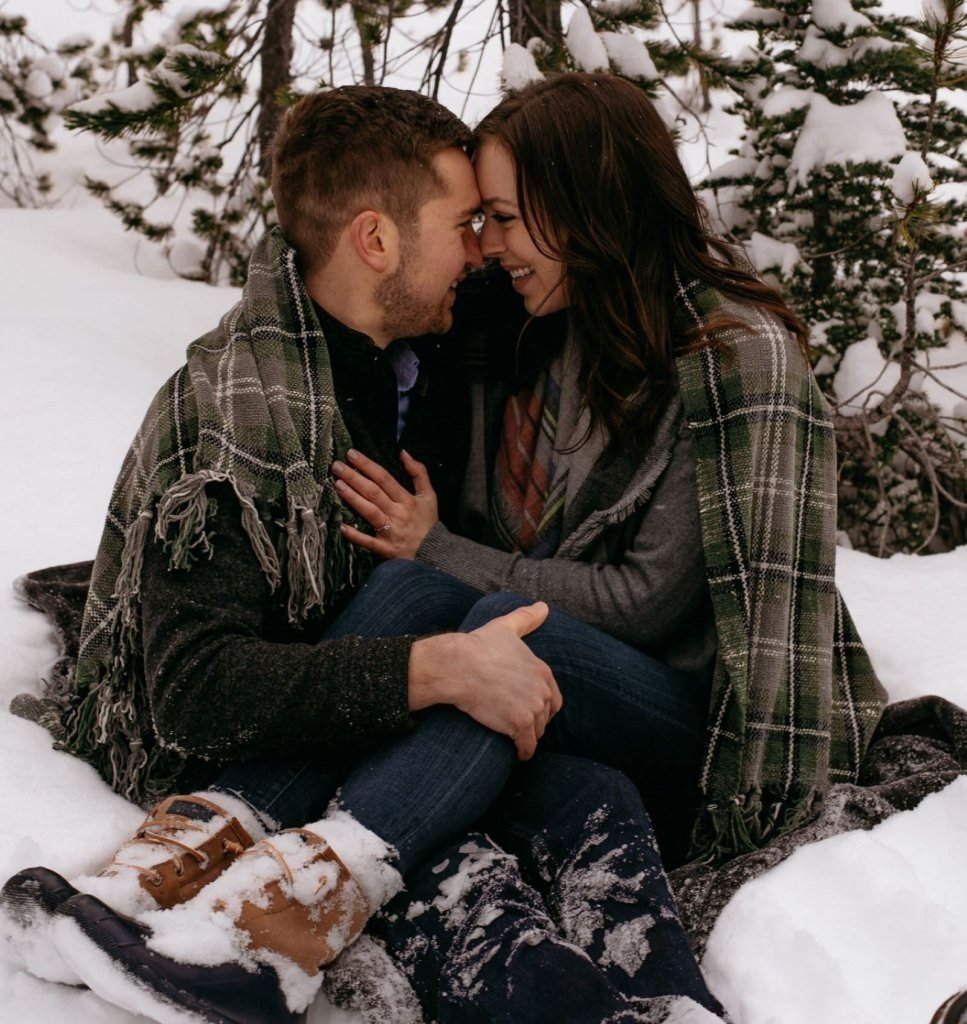 couple cuddling during winter session.