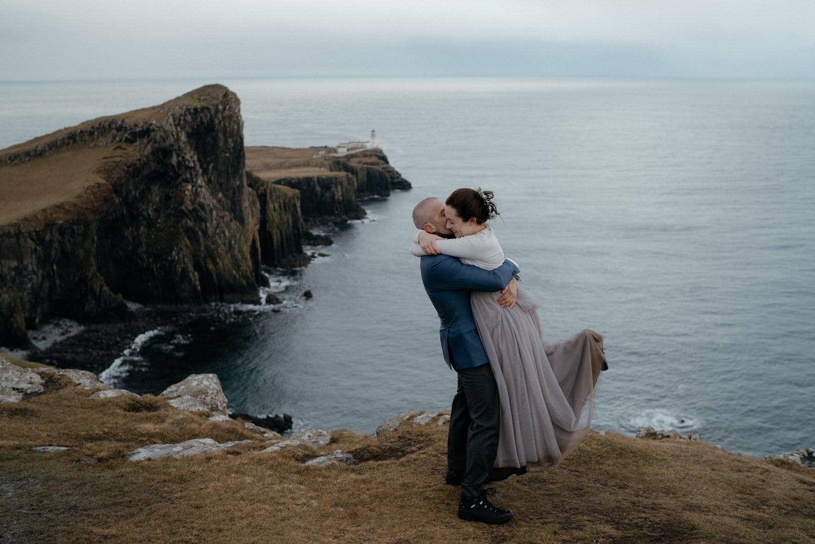 groom lifting bride off her feet in isle of skye scotland highlands