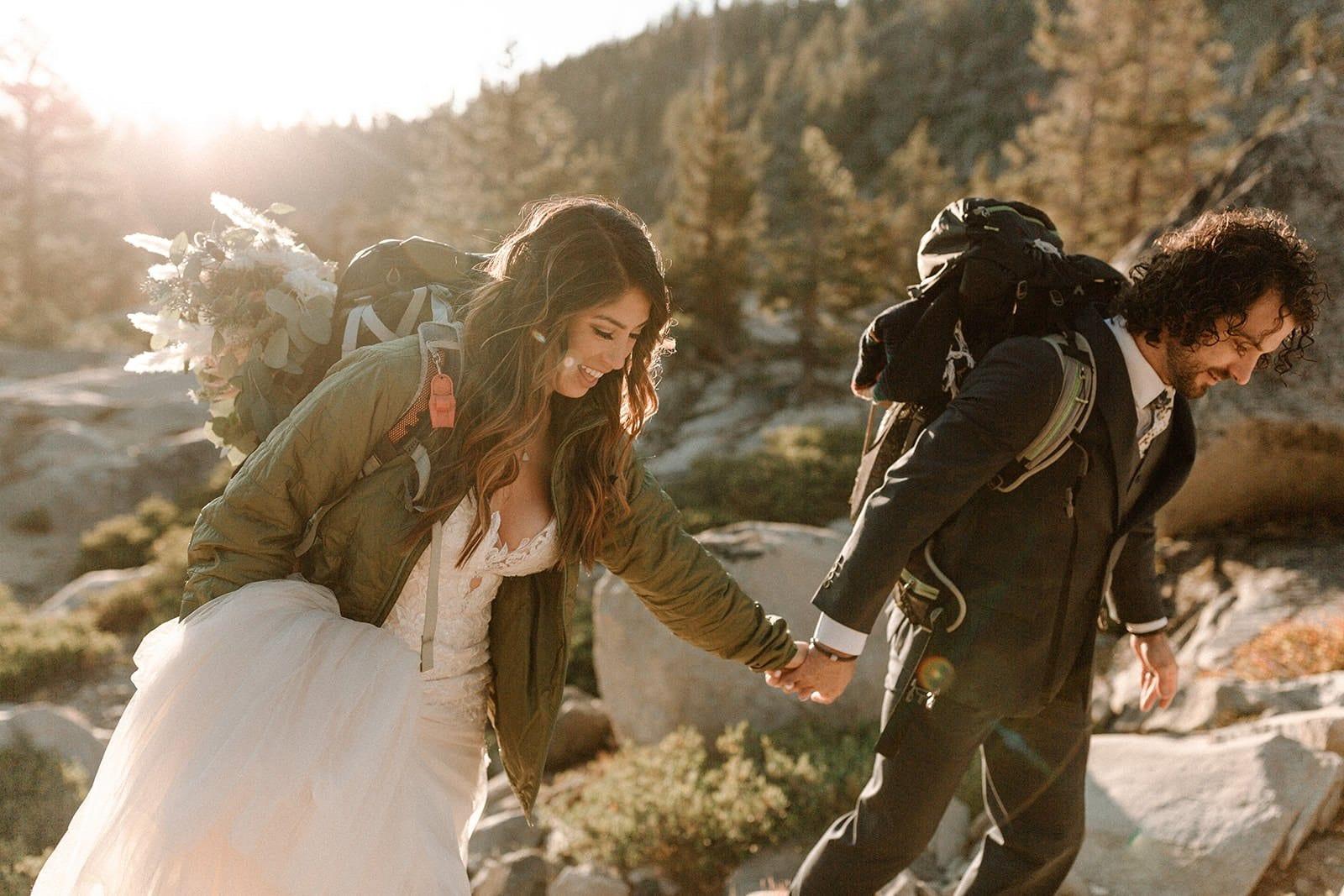 bride and groom hiking
